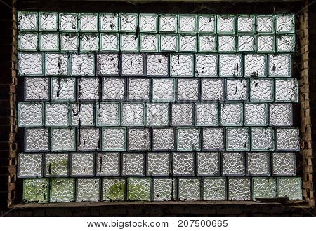 A large window consisting of blocks of figured glass