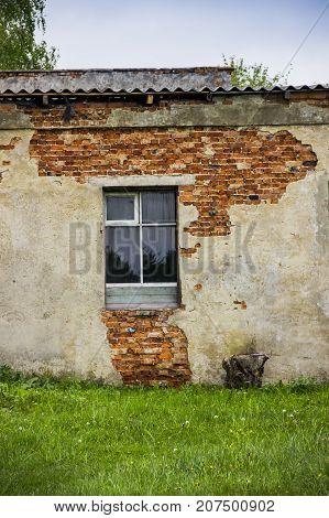 close-up damaged wall of brick barn in countryside
