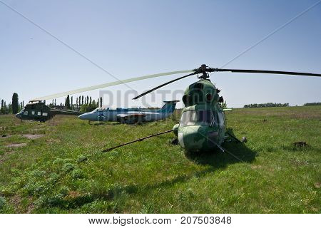 Abandoned Russian military helicopters and planes on derelict airfield