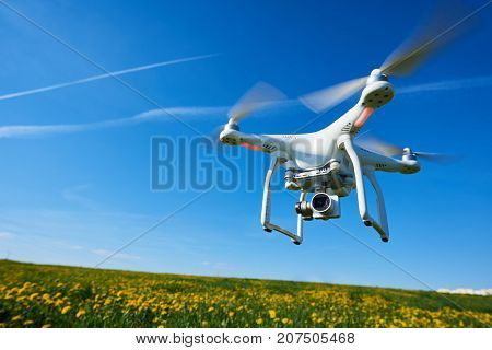 Drone copter flying with digital camera