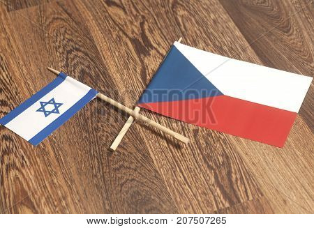 Israel end Czech Republic Flags on a wooden .