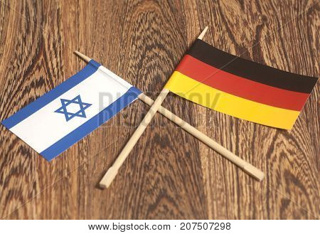 Germany end Israel Flag on wooden background