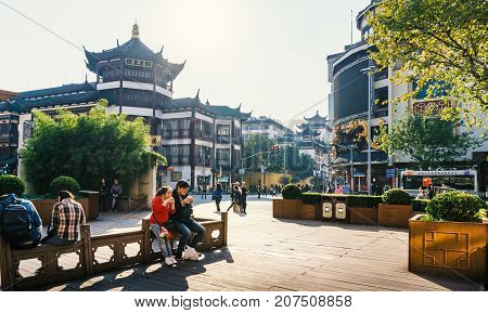 Shanghai, China - Nov 4, 2016: Around Yu Yuan (Yu Garden) - Afternoon street scene near shopping street. People out and about. Street photography.