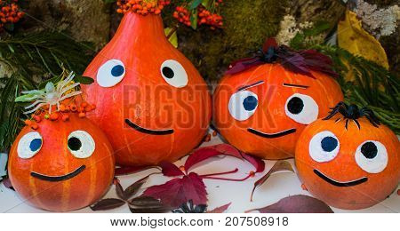 Pumpkin family congratulates on the holiday Helloween.
