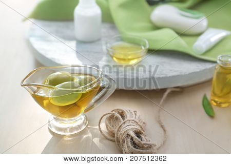 Gravy boat with olive oil on wooden table