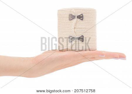 roll of elastic bandage in hand on white background isolation