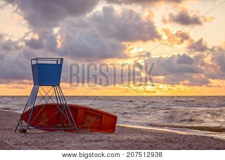 Unmanned and abandoned lifeguard station on the beach at sunset, Baltic sea, Poland