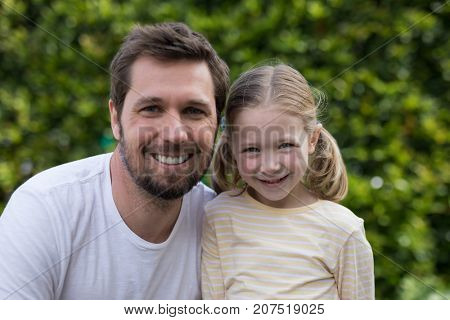 Portrait of father and daughter in the park