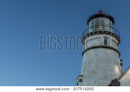 Heceta Head Lighthouse with Blue Sky copy space to left