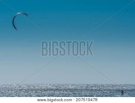 Kite Surfer with Blue Sky on sunny Oregon summer day