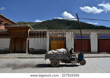 The Life Around Labrang In Xiahe, Amdo Tibet, China. Pilgrims Are Everywhere, Curcumabulating The Mo