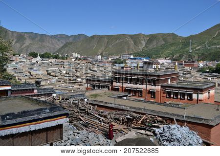 The Life Around Labrang In Xiahe, Amdo Tibet, China. This Monk Stands In The Middle Of Ruins.