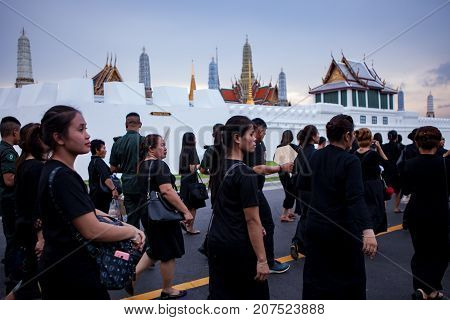 BANGKOK THAILAND - OCTOBER 52017 : thai mourners people wearing black clothes on last day of respect to their beloved king at grand palace