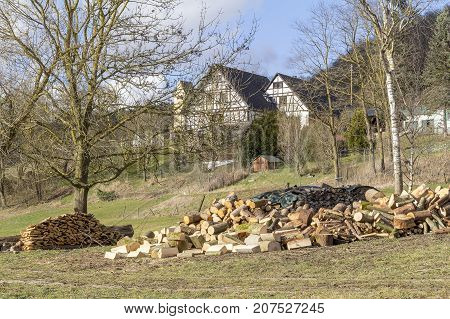 a rural farm house and fuelwood in Hohenlohe a area in Southern Germany at early spring time