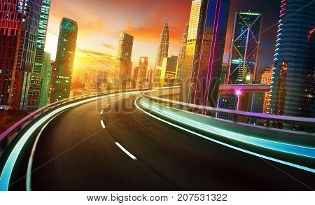 Highway overpass motion blur with city skyline and urban skyscrapers golden hour scene.