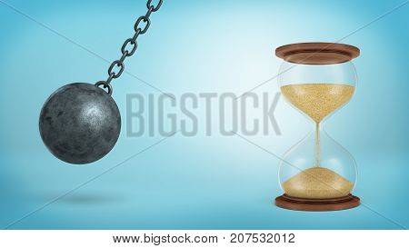 3d rendering of a iron wrecking ball swings on a chain ready to hit a large half-full hourglass on blue background. Time wasters. Future danger. Risk assessment.
