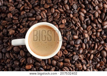 coffee cup espresso on background from cofee beans with copy space. top view.