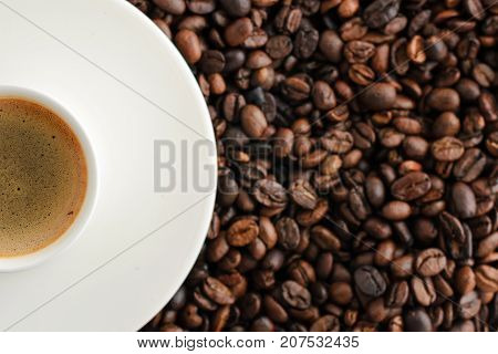 coffee cup espresso with copy spaceon background from cofee beans close up. top view.