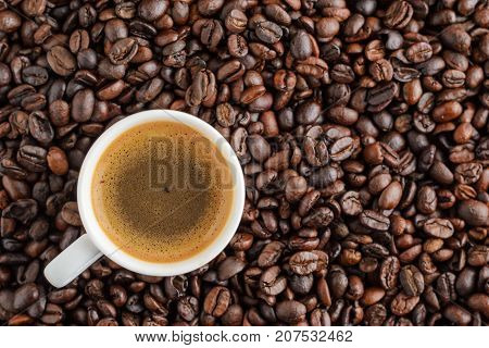 coffee cup espresso with copy space on background from cofee beans. top view