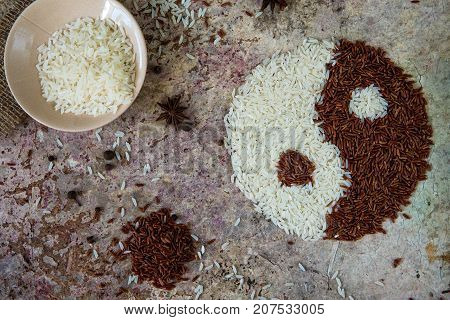Rice Yin And Yang Concept. Red And White Rice Top View
