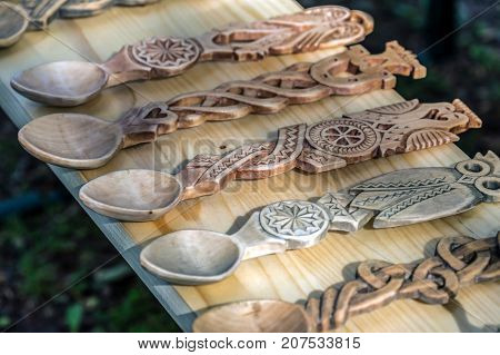 Decorative wooden spoons carved with traditional Romanian patterns.