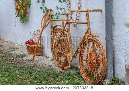 Decorative bike for ornamental garden made from twigs and wicker.