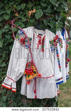 Old traditional Romanian folk costumes with embroidery specific for Bistrita-Nasaud area Romania exposed at one traditional fair.