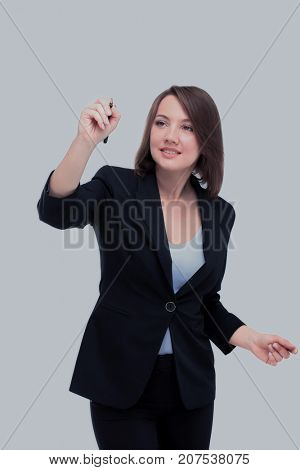 Beautiful businesswoman writing with a pen, white background