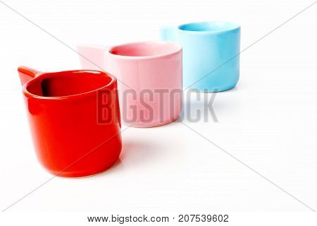 Group of colorful empty cup isolated on white background.