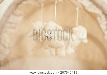 Three little bear toy in the crib