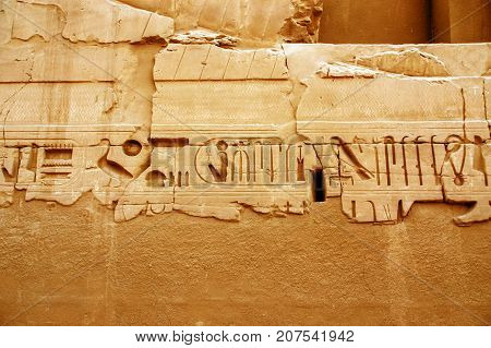 Egyptian hieroglyphics carved in stone. Egyptian Ruins