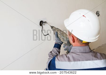 Builder Drills A Hole In The Wall