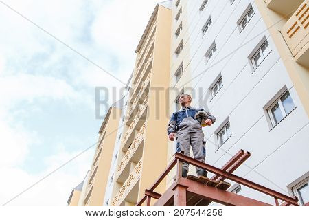 Builder Against The Backdrop Of A New Building