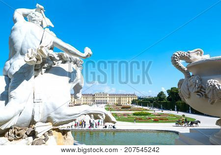 Vienna Austria - August 7 2016: The garden and the rear facade of the Schonbrunn Palace seen from the Neptune fountain