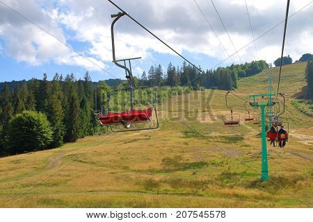 The picture was taken in Ukraine. On the photo there is a cable car leading to the top of Mount Gemba.