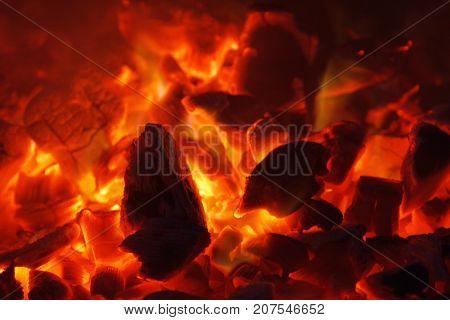 Glowing hot charcoal briquettes close-up background texture. bonfire coals
