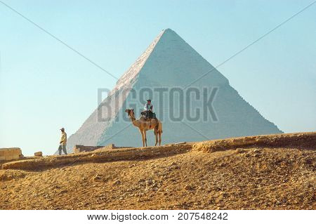 GIZA EGYPT - Nov 02 2007: Police on a camel in the background of the pyramid