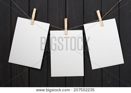 Blank White Paper Cards Hanging On Clothespins