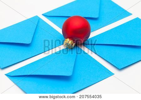 Different colored envelopes and Christmas decoration on the table