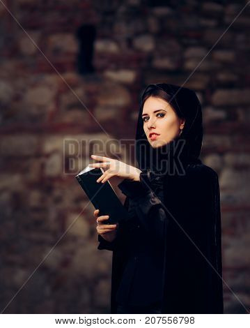 Beautiful Witch Princess Reading a Spell Book