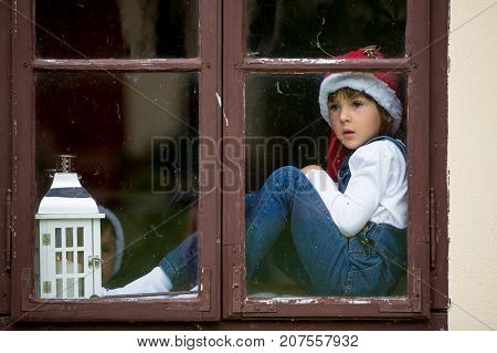 Two Cute Boys, Brothers, Looking Through A Window, Waiting For Santa