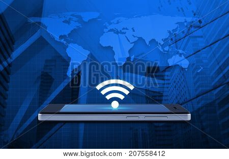 wi-fi button flat icon on modern smart phone screen over world map and office city tower Technology and internet concept Elements of this image furnished by NASA