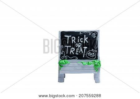 Halloween concept : Dirty ceramic Trick or Treat sign isolated on white background