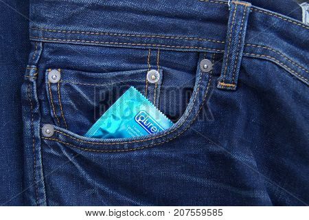Almere, The Netherlands - October 6, 2017: Durex condom in the pocket of blue jeans.