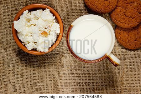 Diet cookies with oatmeal and milk on sackcloth. close-up