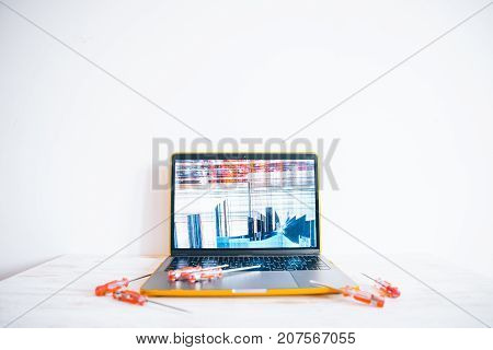 laptopr with cracked screen with repair tools