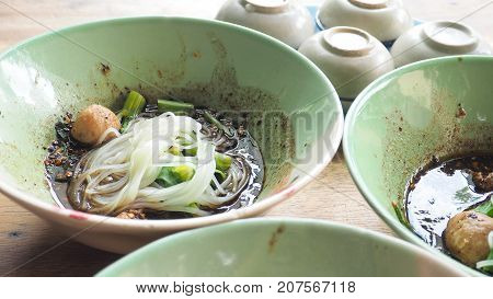 Boat noodles beef super spicy Thai food has meatballs The soup is blood also contains nam tok are commonly served with ice in stainless cup and Steamed Pandanus Cake Photo full frame