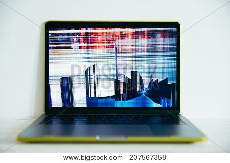 laptopr with cracked screen on white background