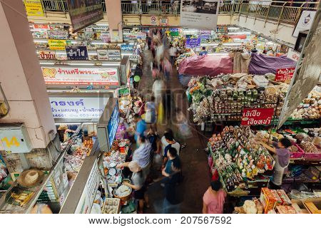 CHIANG MAI THAILAND - AUGUST 27: A group customers crowds near a food stall at the Warorot market on August 27 2016 in Chiang Mai Thailand.
