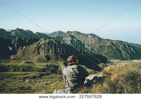 Man relaxing at mountains landscape Travel Lifestyle wanderlust adventure concept summer vacations outdoor into the wild
